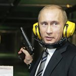 Russian President Putin stands with a gun at a shooting gallery in Moscow