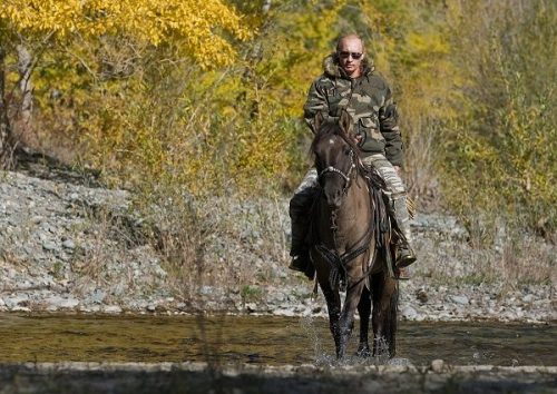 Russia's Prime Minister Putin rides a horse as he takes part in an expedition to Ubsunur Hollow Biosphere Preserve to inspect the snow leopard's habitat in Tyva Republic in the Siberian Federal District